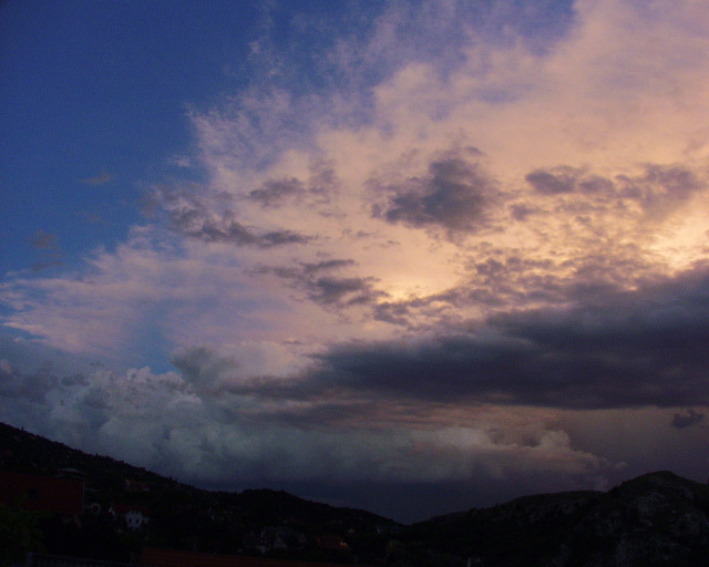Stormcloud edge at sunset